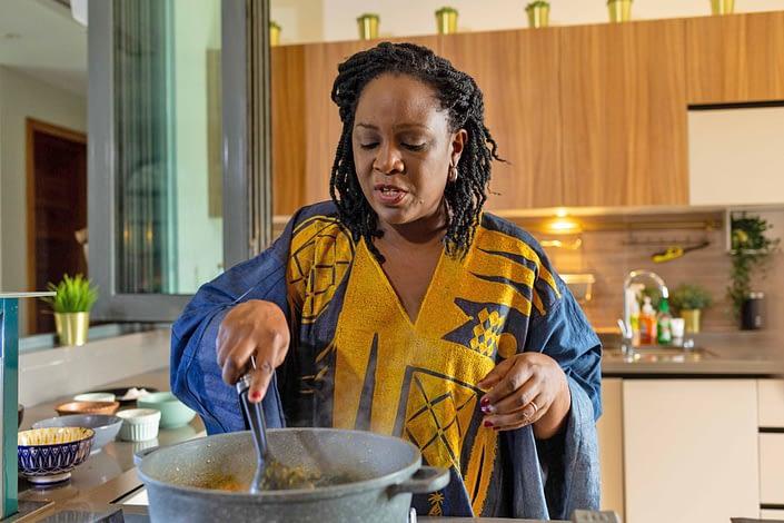 Tola Akerele cooking in her kitchen