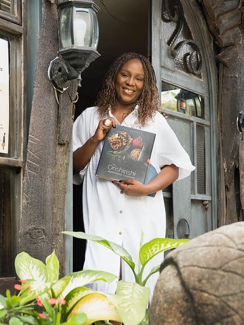Tola Akerele with her book The Orishirishi Kitchen